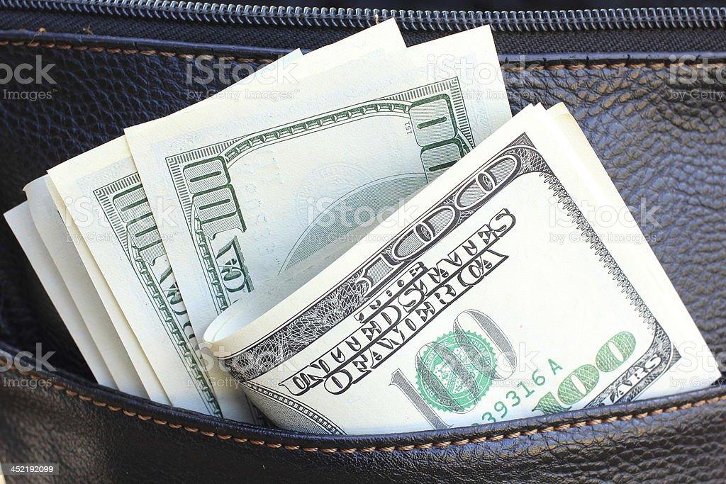 Many dollars banknotes stock photo
