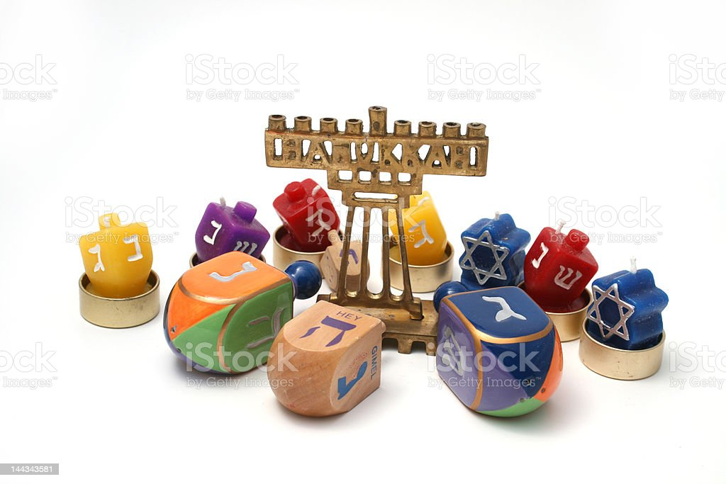 Many Dreidals and small hannukia for Hannukah stock photo