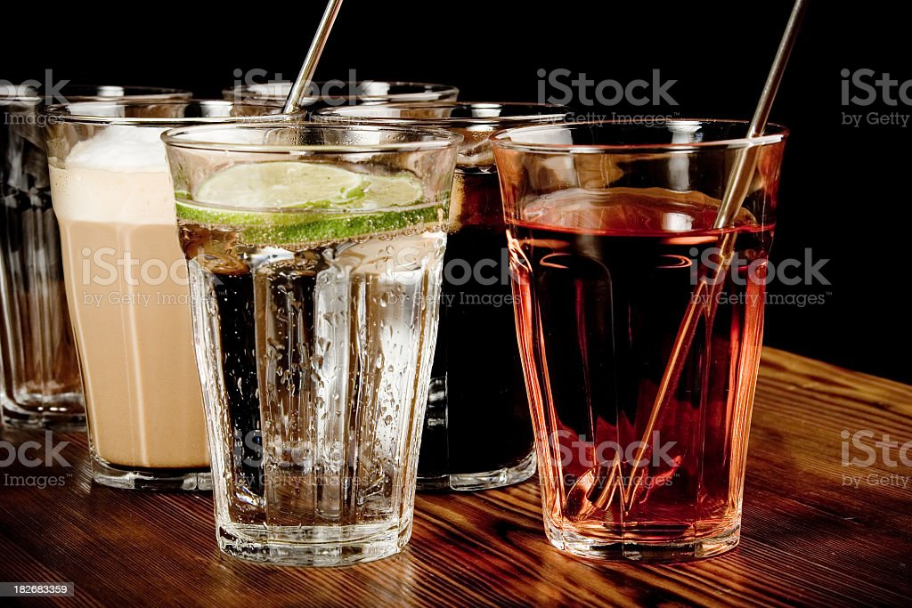 Many drinks in a glass on a wooden countertop stock photo