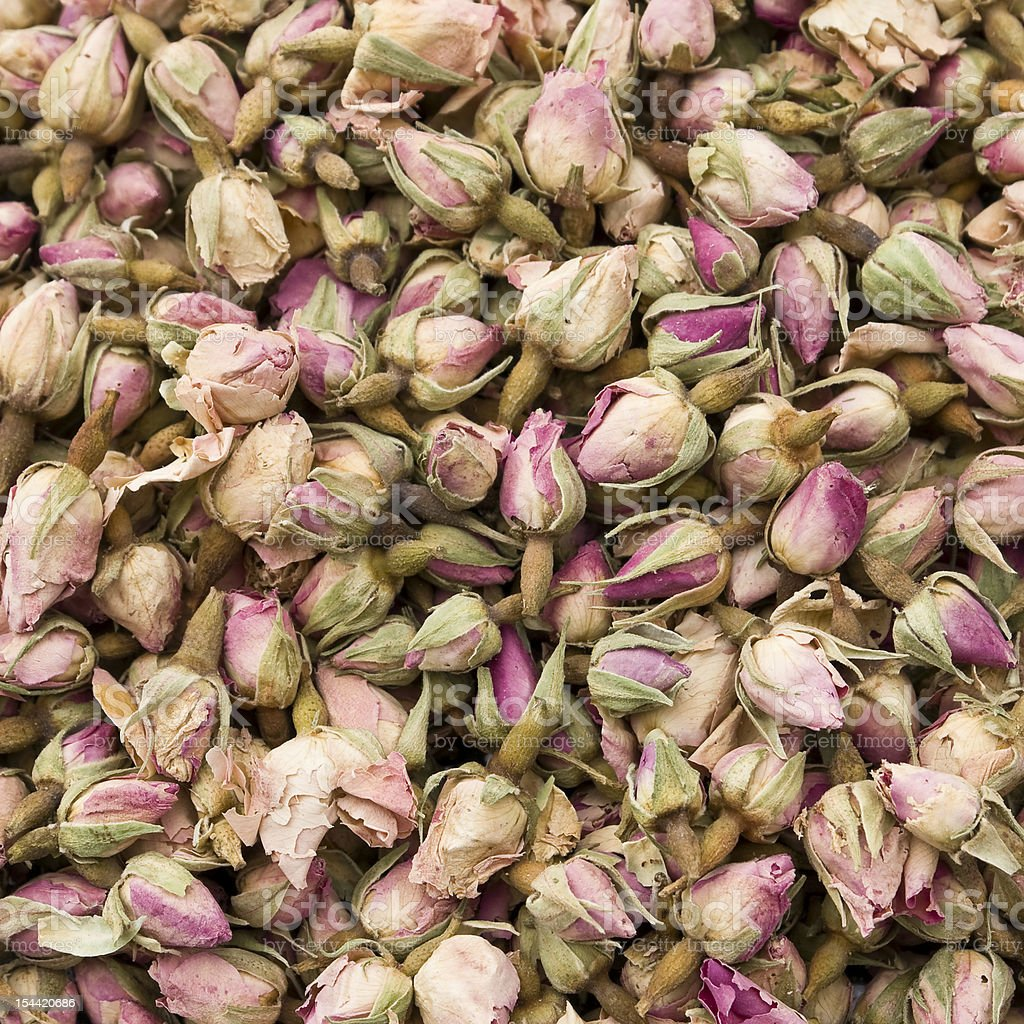 Many dry small rose buds for tea background royalty-free stock photo