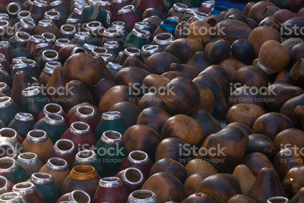 Many dry yerba mate gourd with metal nozzle stock photo