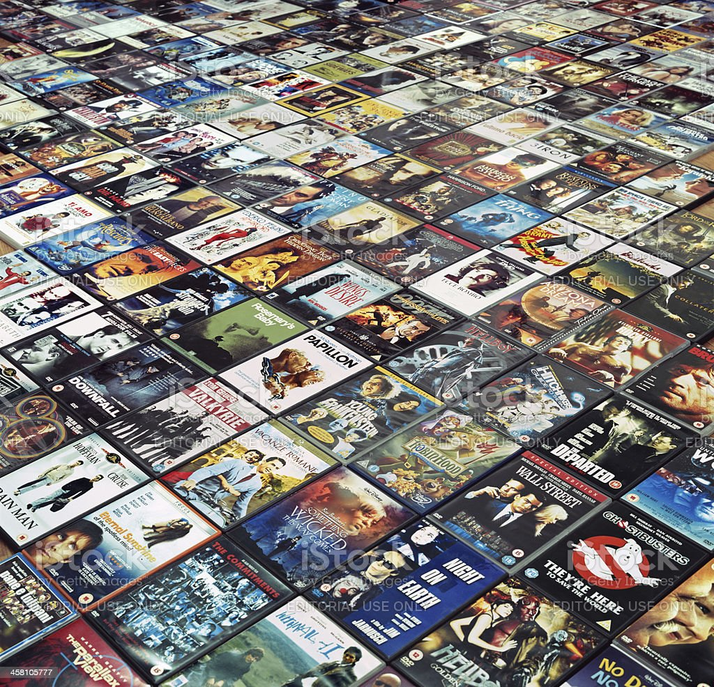 Many DVDs are arranged side by side on the floor stock photo