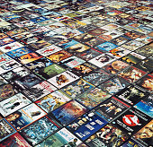 Many DVDs are arranged side by side on the floor