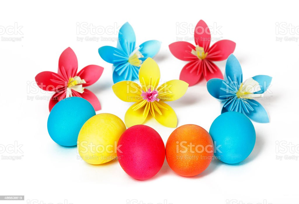 Many Easter eggs and colored paper flowers royalty-free stock photo