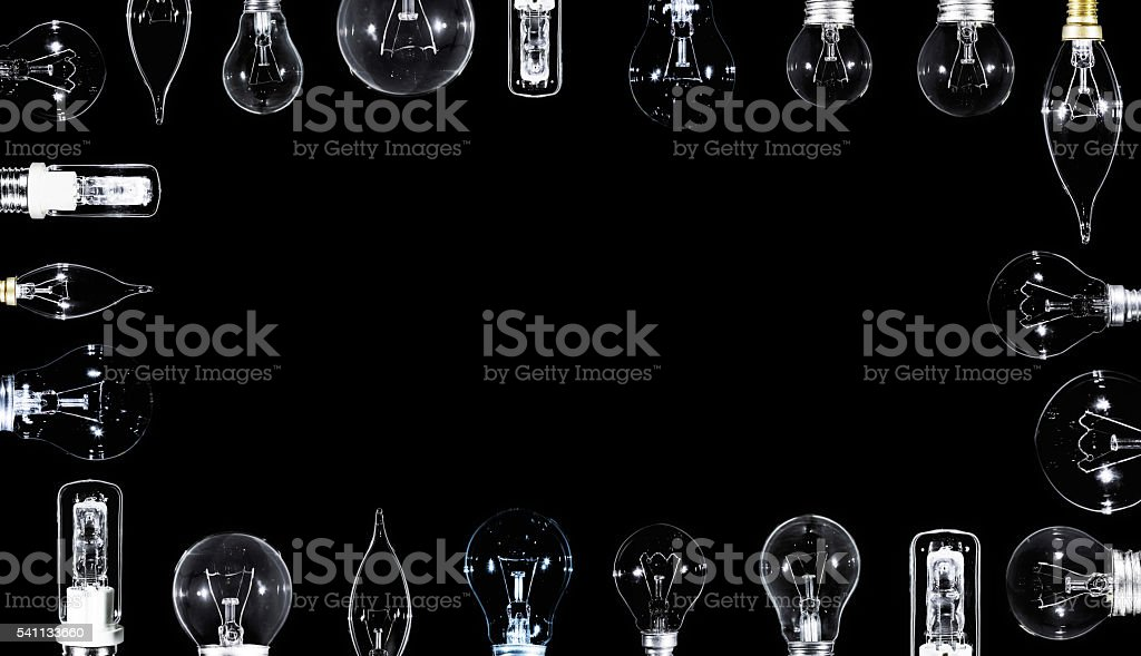 Many Edison lamps over black, copyspaced stock photo