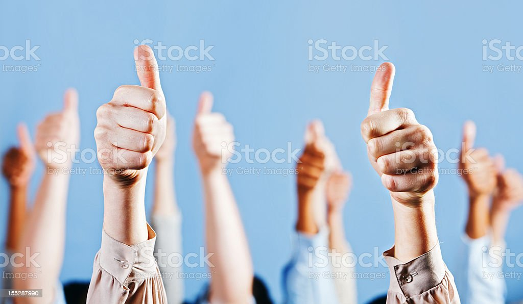 Many enthusiastic and approving Thumbs Up signs royalty-free stock photo
