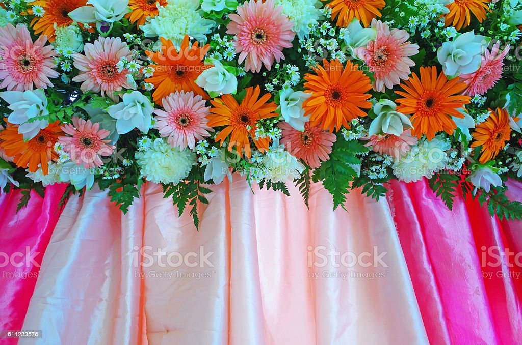 Many flowers on the colorful cloth stock photo