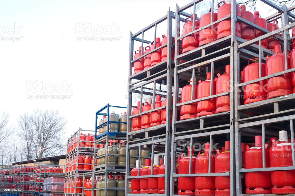 Many gas bottles in a depot stock photo