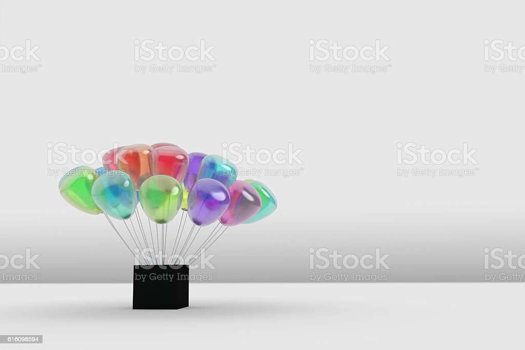 many gauzy colorful balloon planting at a black box stock photo