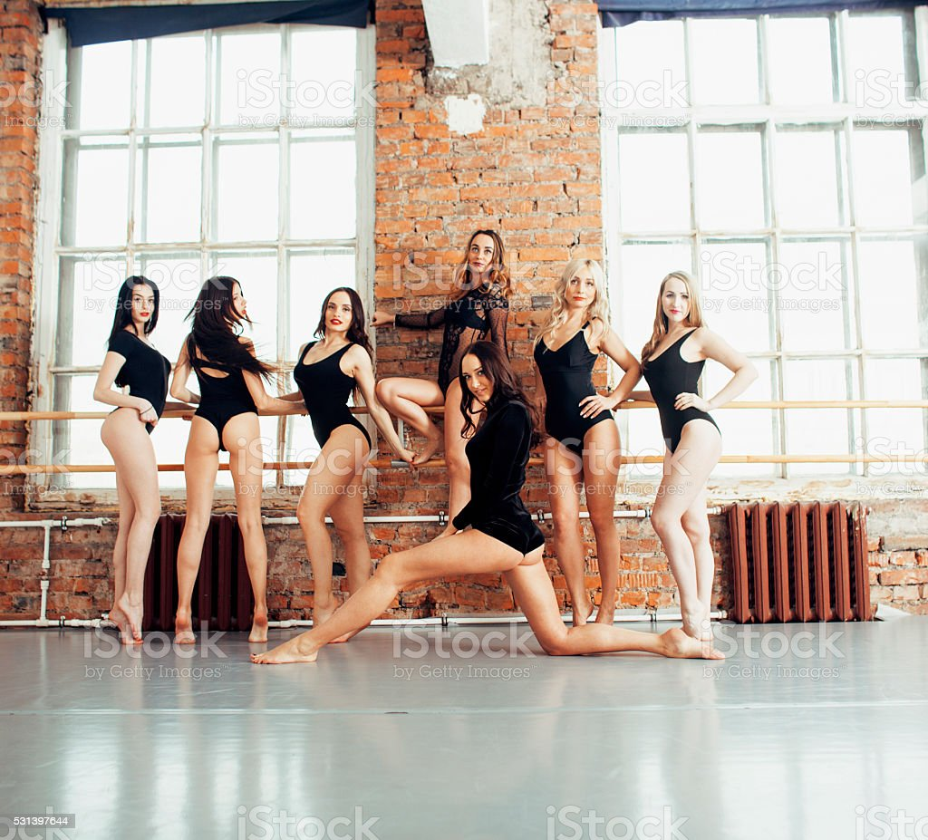 Many girls training in studio ballet, long woman legs sexy stock photo