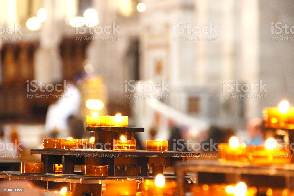 Many golden candle stock photo