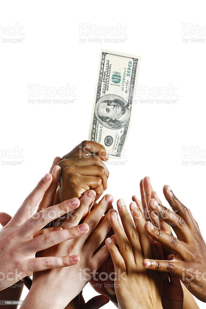 Many greedy hands grab for $100 bill stock photo