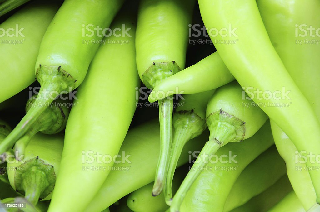 Many green chili peppers, Food raw material royalty-free stock photo