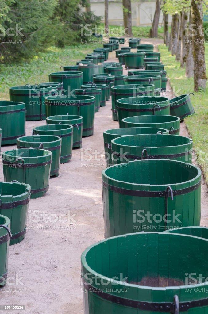 Many green wooden barrels stock photo