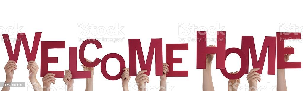 Many Hands Holding a Welcome Home stock photo