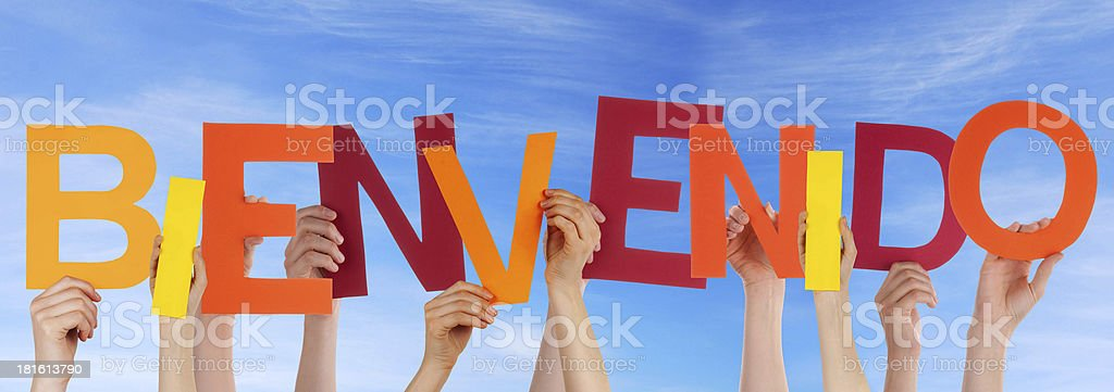 Many Hands Holding Bienvenido in the Sky royalty-free stock photo