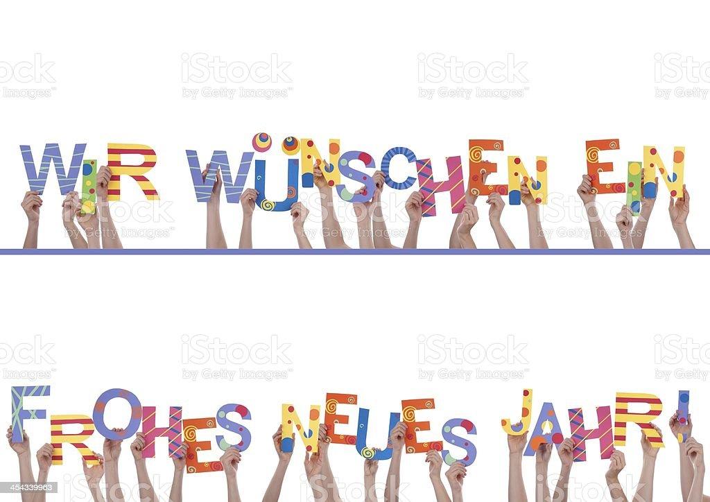 Many Hands Holding Wir Wuenschen Ein Frohes Neues Jahr stock photo