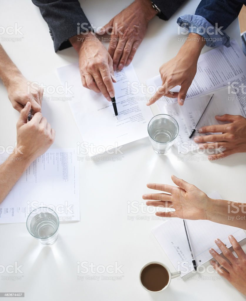 Many hands make light work stock photo