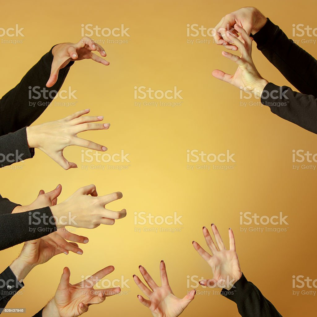 Many hands reaching out up in the air stock photo