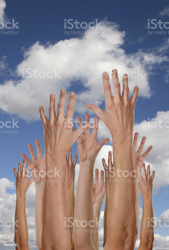 Many Hands Reaching To The Sky royalty-free stock photo