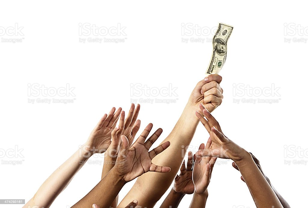 Many hands try to grab $100 bill stock photo