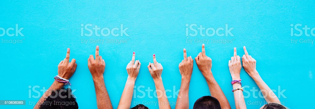 Many hands with an offensive gesture stock photo
