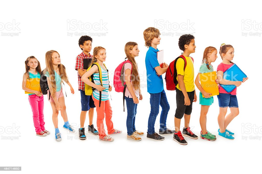 Many happy kids in a line to school stock photo