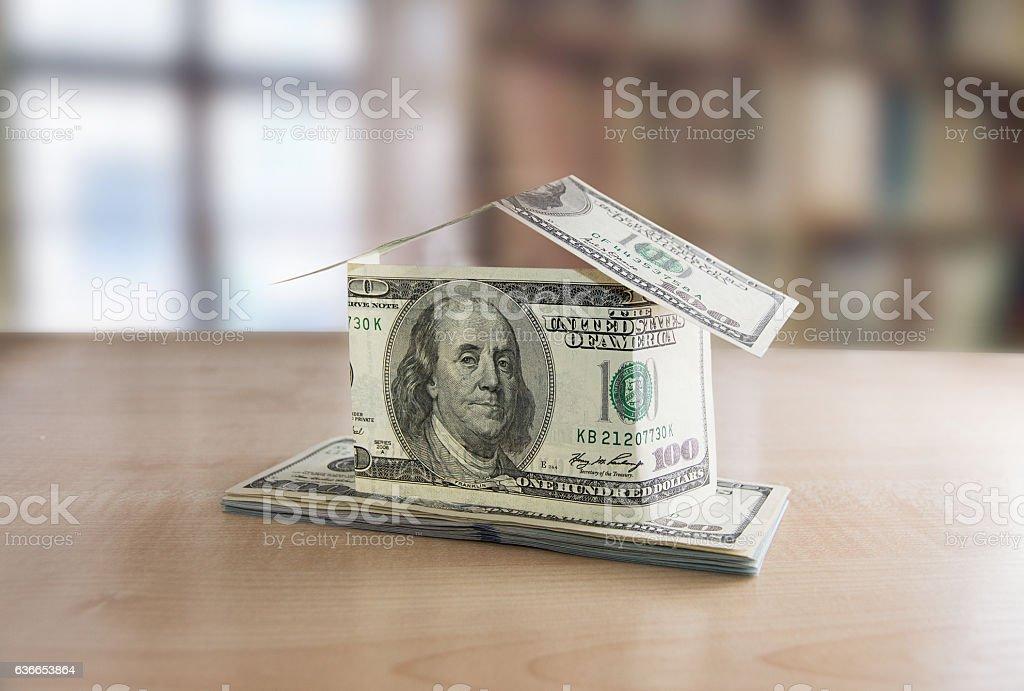 Many hundred dollar bills on wooden table stock photo