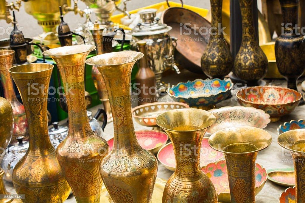Many interesting cookware at flea market stock photo