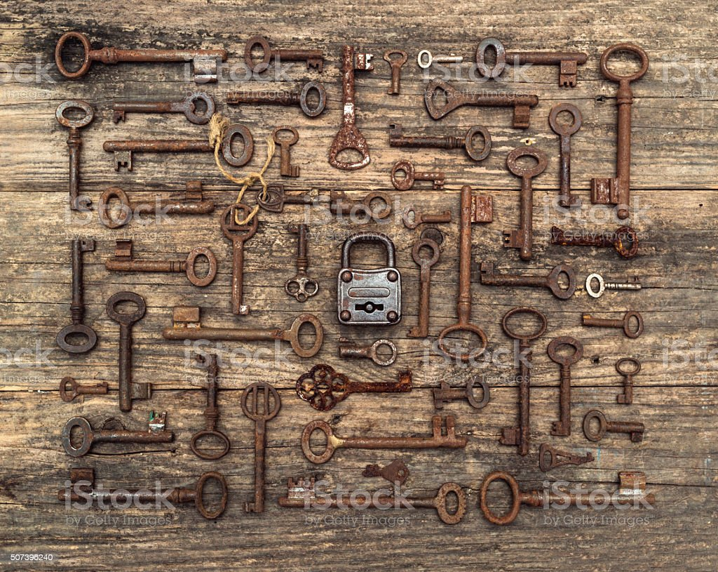 many keys on wood with padlock stock photo