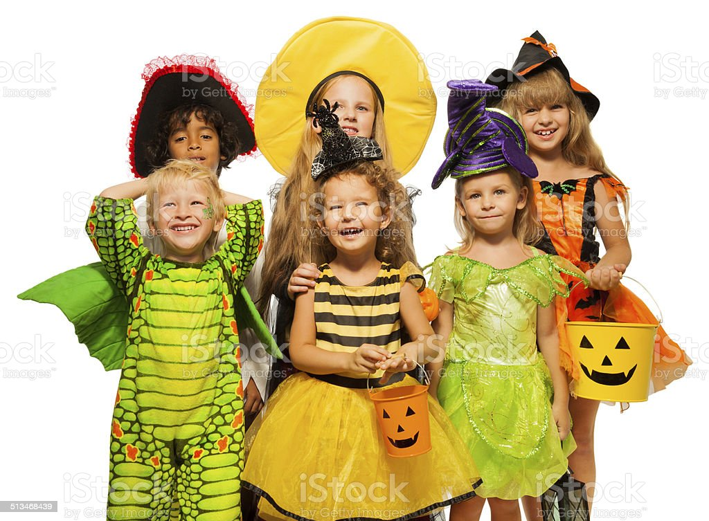 Many kids in Halloween costumes, boys and girls stock photo