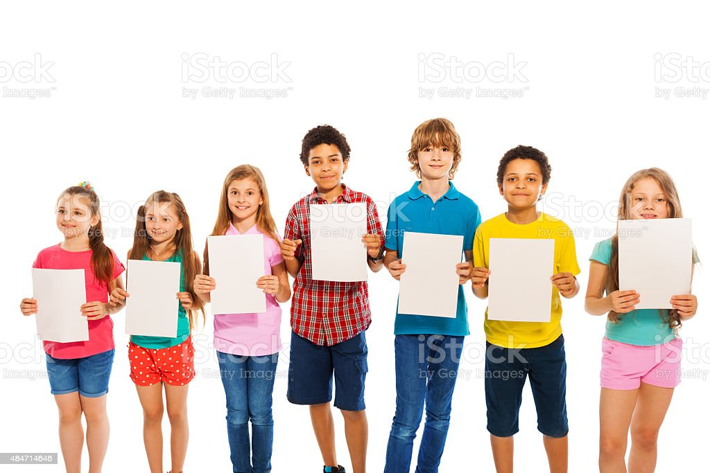 Many kids stand with blank paper sheets in line stock photo