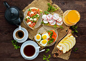Many kinds of sandwiches, bruschetta, and tea, coffee, fresh juice