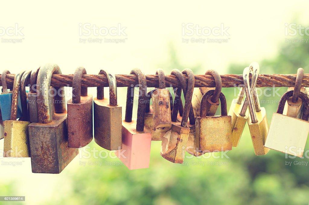 Many love key lock concept on sling pastel tone stock photo