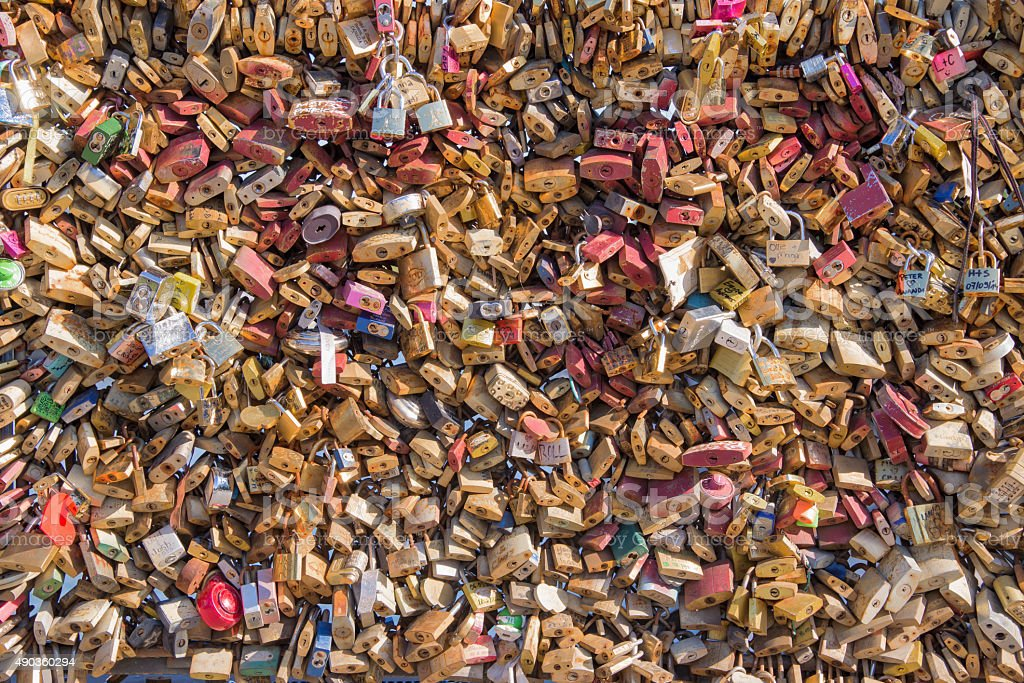 Many love lockers on a bridge in Paris, France stock photo