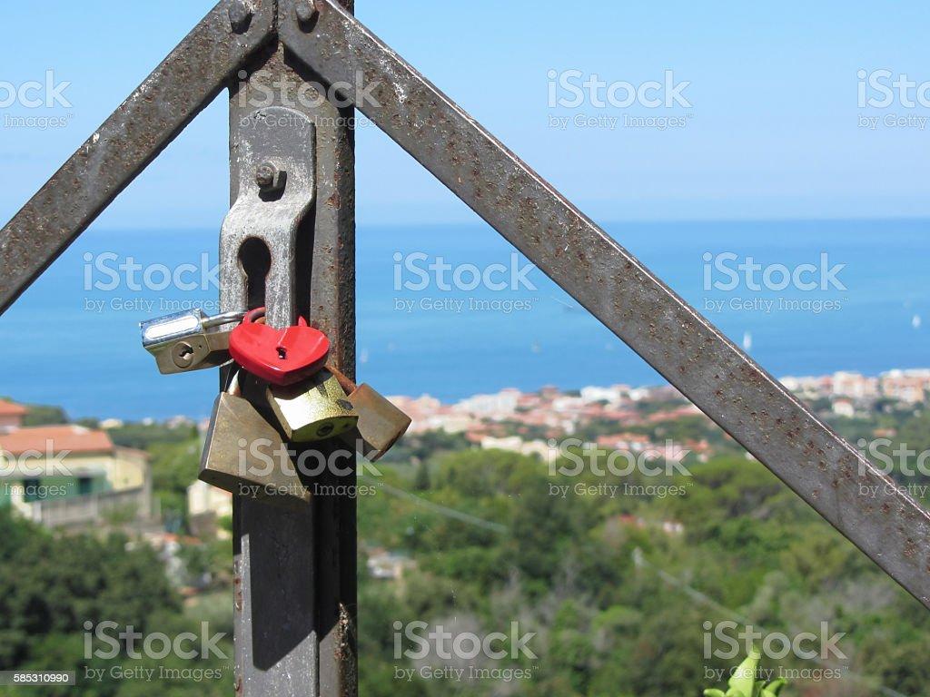 Many love padlocks, one heart shaped stock photo