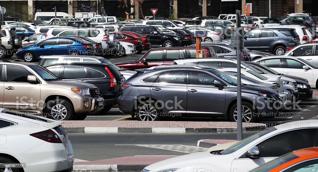 Many luxury cars parked in a parking place stock photo