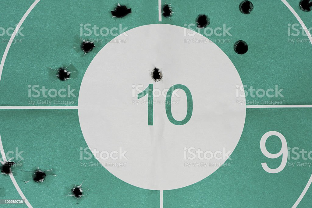 Many miss and one hit at bullseye stock photo