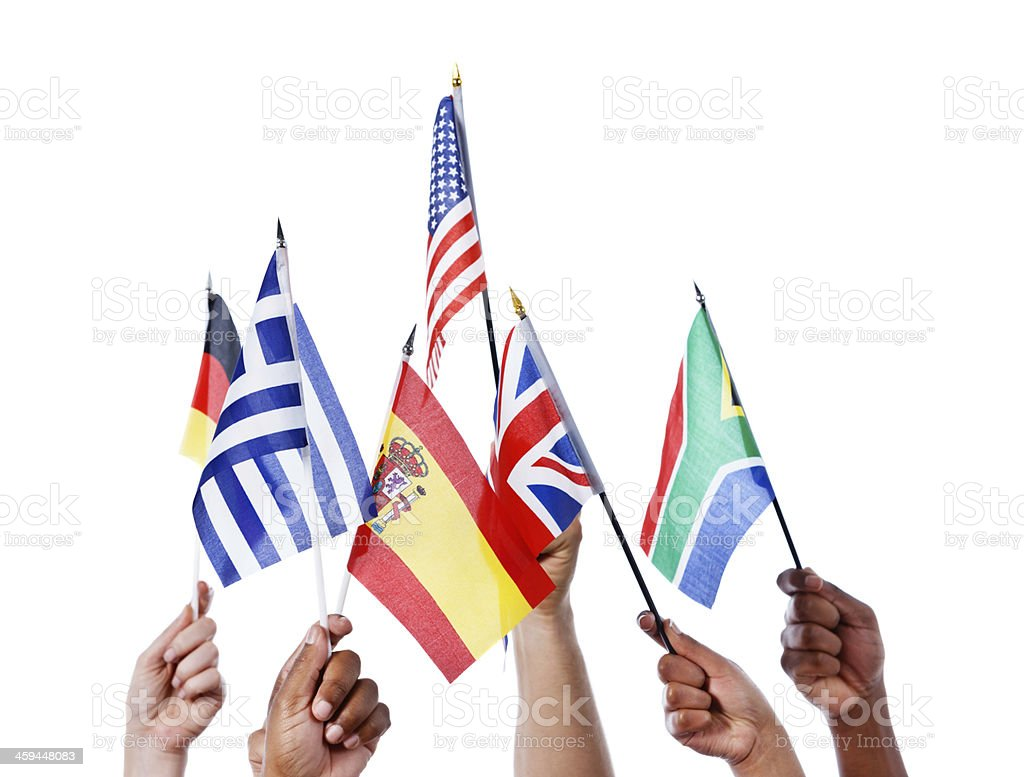 Many mixed hands waving varied national flags stock photo