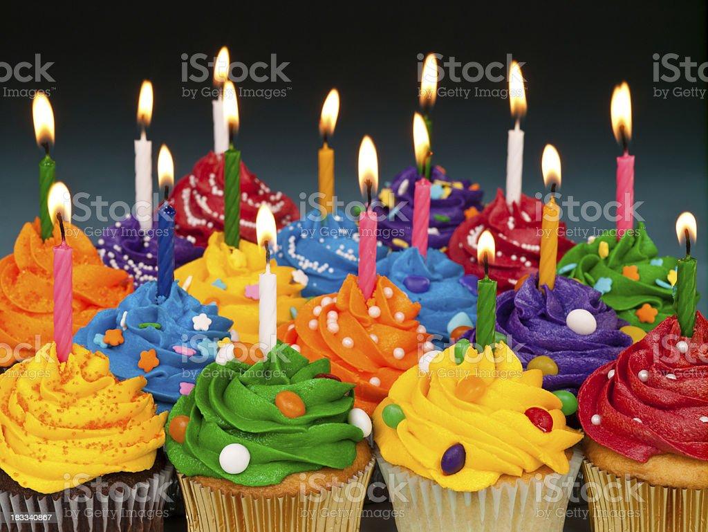 Many multi colored Birthday cupcakes stock photo