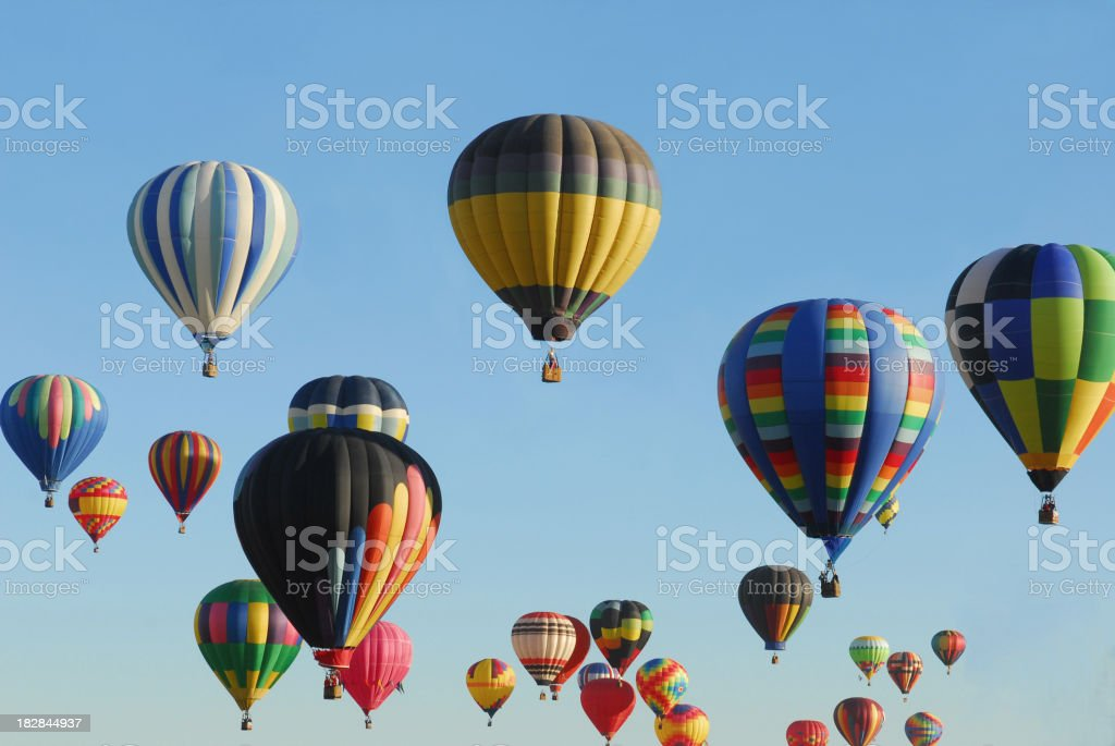 Many multicolored hot air balloons in the clear blue sky royalty-free stock photo