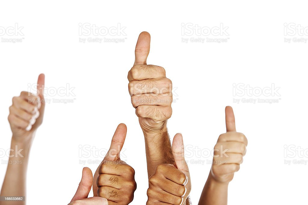 Many multiracial hands give thumbs up sign of approval royalty-free stock photo