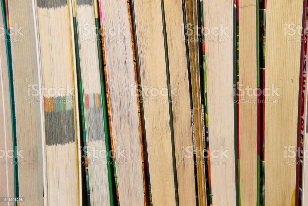 Many new books on a shelf stock photo