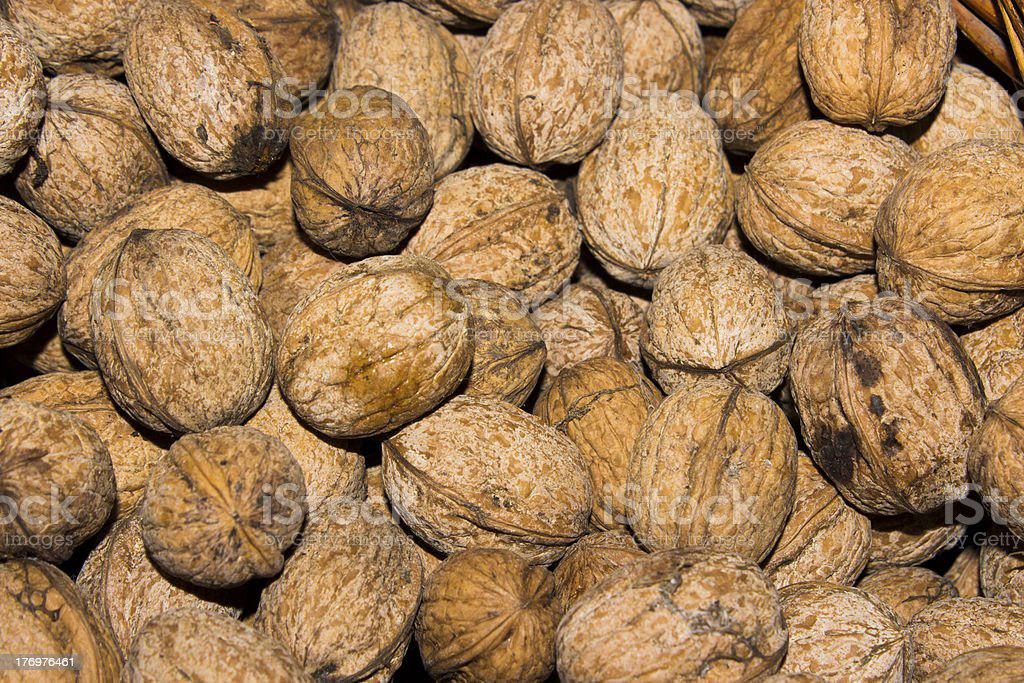 many nuts in a basket stock photo