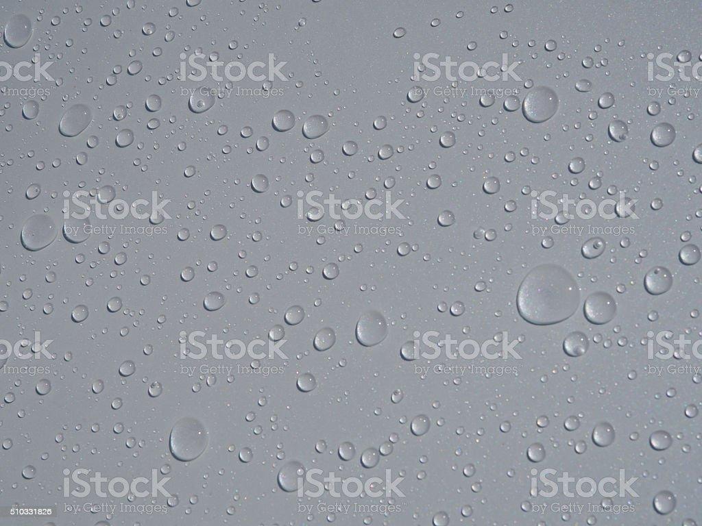 Many of raindrops stuck on the Car Hood background, stock photo