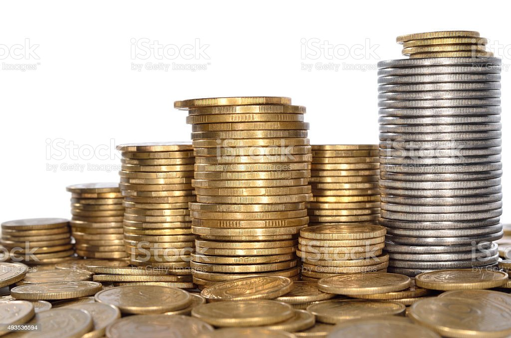 Many of shiny coins of yellow metal stock photo