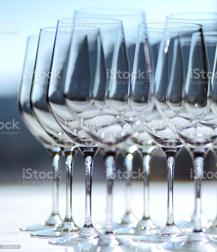 Many of wine glasses in row stock photo