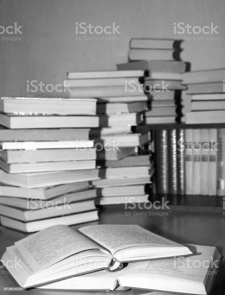 Many old books combined by a heap stock photo