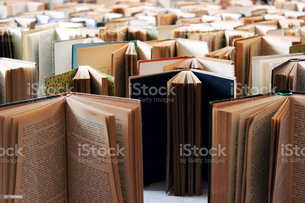 Many old books in a row stock photo