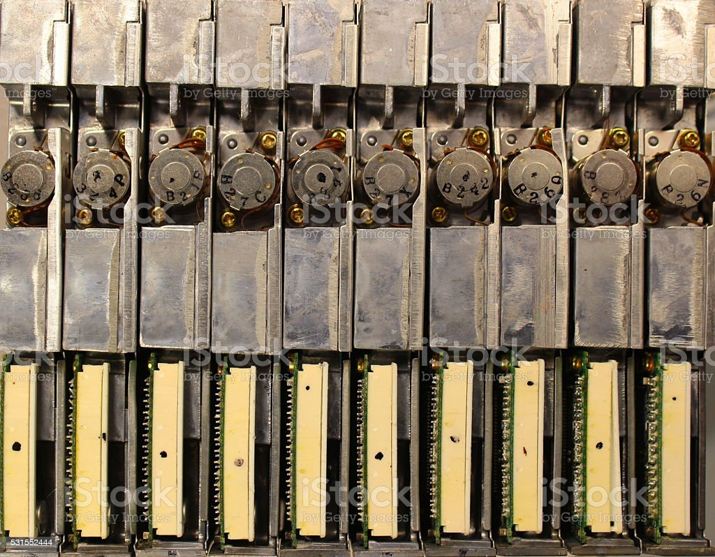 Many old retro floppy drives from laptop computers. stock photo